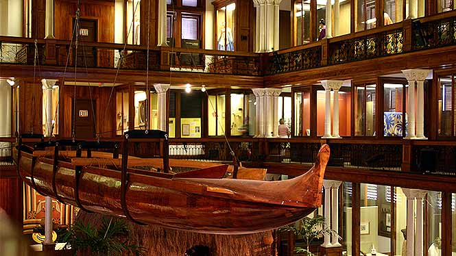 Inside the Bishop Museum looking at a canoe