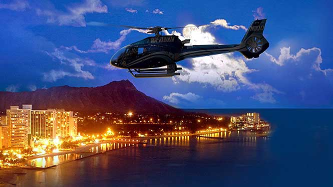 Helicopter flying over waikiki lights