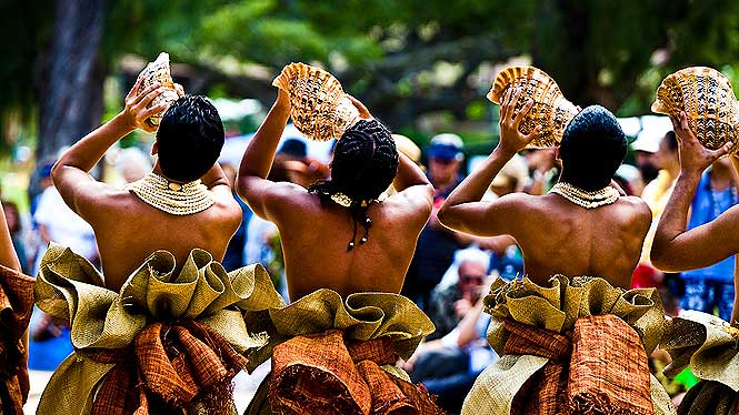Hula dancers with conch shell kicking off the Aloha Festivals