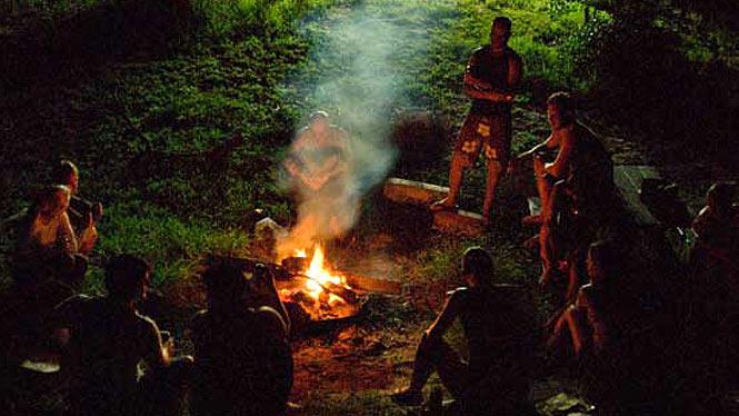 standing around a campfire