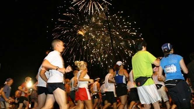 Honolulu marathon with fireworks in background
