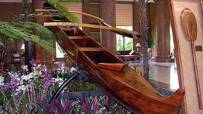Traditional Koa conoe and paddle