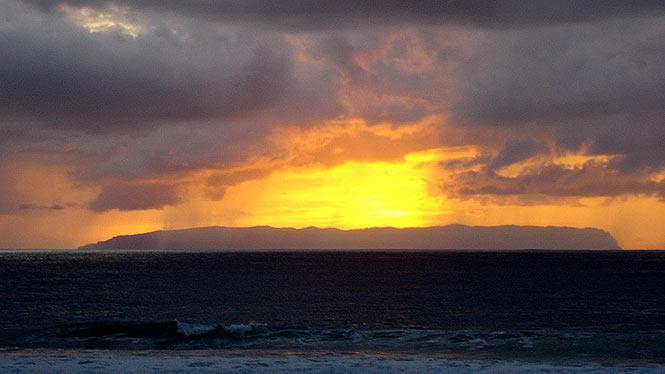 view of sunset over Niihau from Kauai