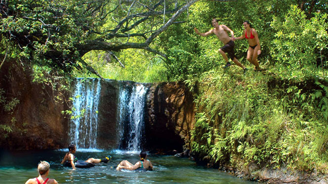 Swimming in a secluded water holw with a small waterfall