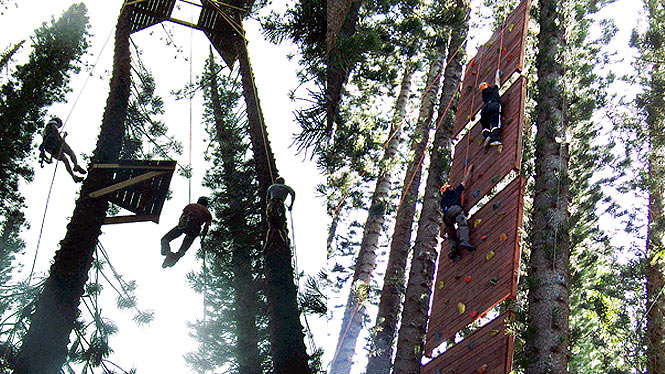 climbing a wall and repelling