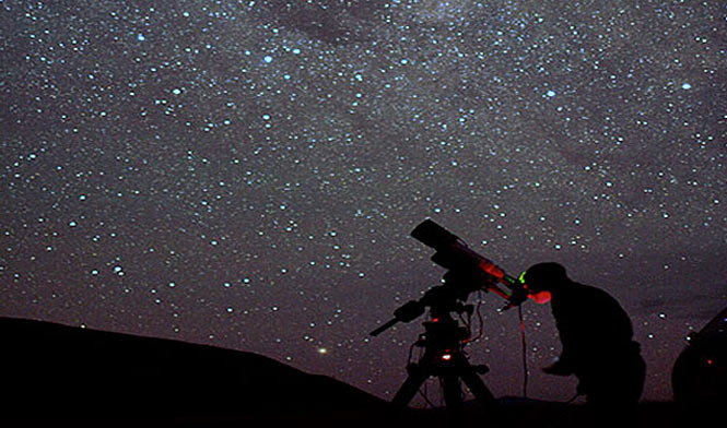 Person taking pictures of the stars at night