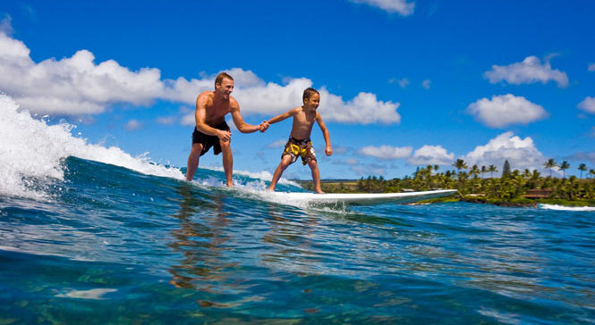 Young boys first Hawaii surf lesson
