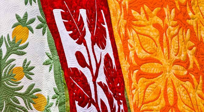 Several Hawaiian quilts hanging