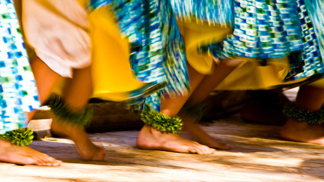 Men's feet dancing Hawaiian hula