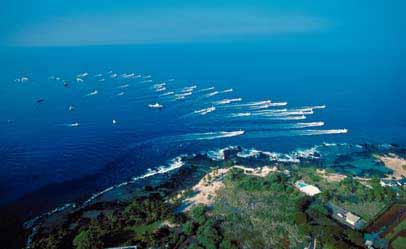 Boats heading out at Kailua-Kona harbor
