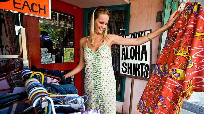 lady shopping for aloha shirts