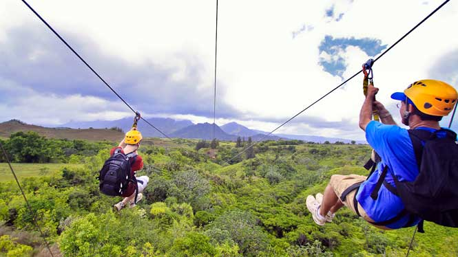 Two people ziplining with a beatifull background