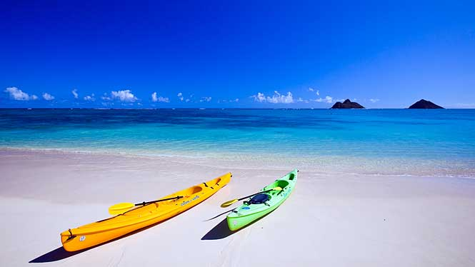 2 kayaks at Lanikai Beach with islet in background.