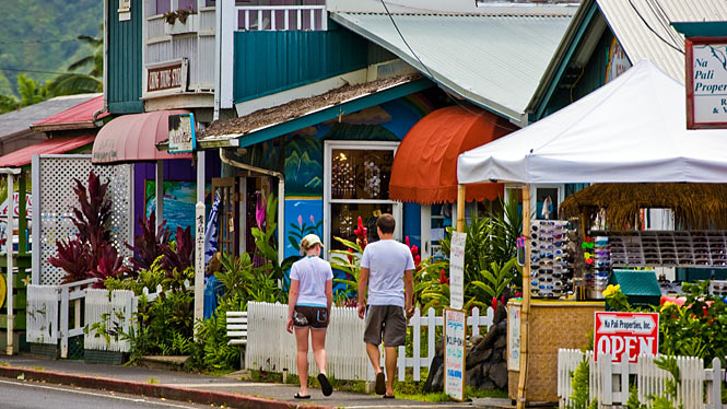 Couple walking through Hanalei Town