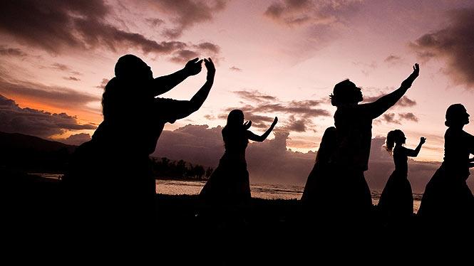 practicing hula at sunset