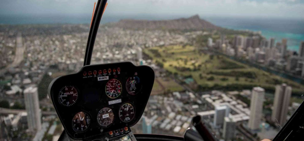 Above Waikiki in a helicopter with view of Diamond head in distance.