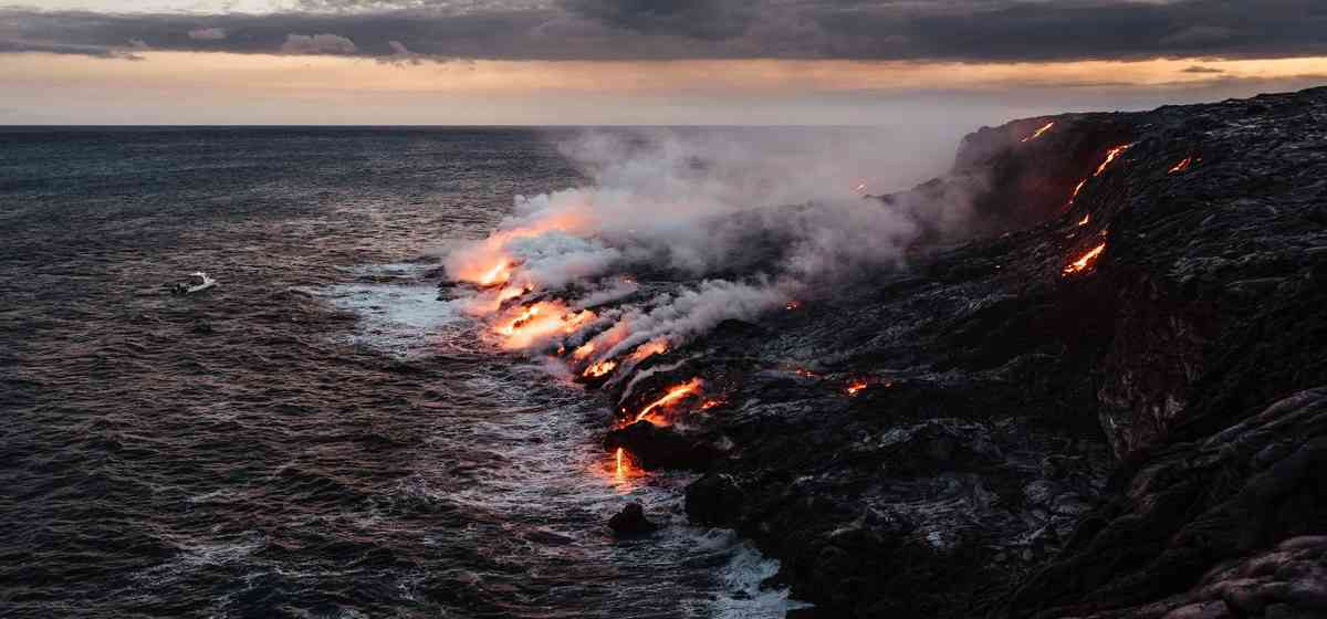 Hawaii lava flowing into ocean on the Big Island.