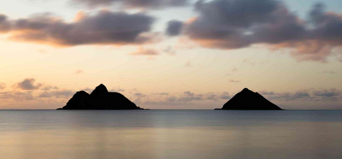 sunset view of the mokes islands from Lanikai beach