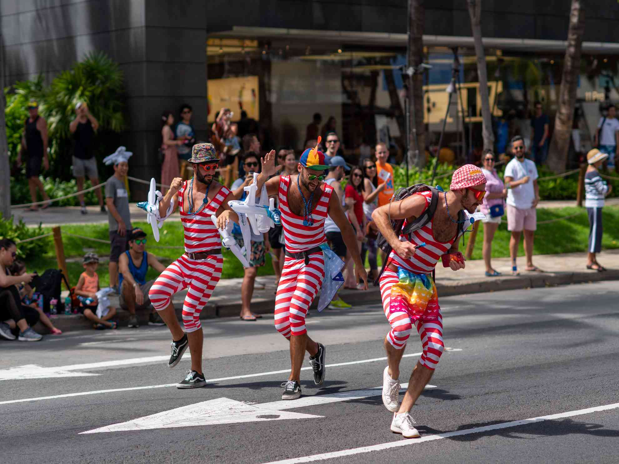 A parade in downtown waikiki always Things To Do on Oahu