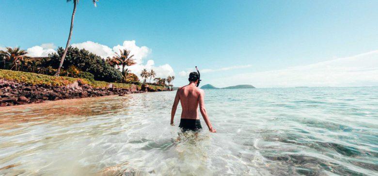 Man snorkeling in Hawaii from beach in Honolulu